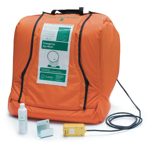 A photograph of the Guardian G1540HTR AquaGuard Gravity-Flow Portable Eye Wash with the jacket shut, showing the wall hanging bracket, power cord, and bottle of Aquasep preservative.