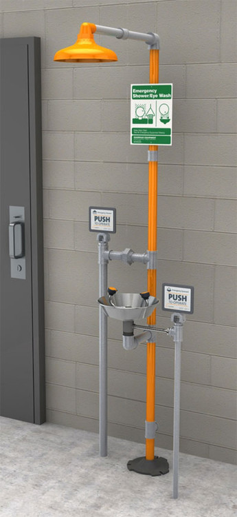A photograph of a Guardian GFR1902SSH Freeze-Resistant Safety Station with Eyewash and stainless steel bowl installed next to a cinderblock wall.