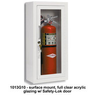 A photograph of a 09320 ambassador steel trim and door fire cabinet with fire extinguisher installed.