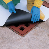 A photograph of a 04005 magnetic drain mat being installed over drain.