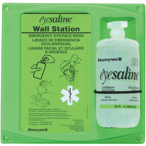 One bottle Honeywell eyewash station with a green backer/mounting board w/ usage instructions and a 32 ounce bottle of Eyesaline® mounted on it.