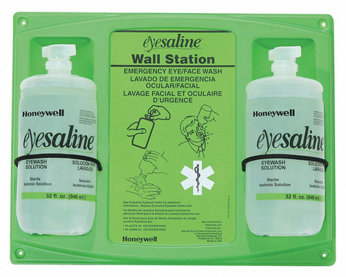 Two bottle Honeywell eyewash station with a green backer/mounting board w/ usage instructions and two 32 ounce bottles of Eyesaline® mounted on it.