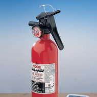 A photograph of a red 09379 no flag polypropylene fire extinguisher seal with 100 per package installed one fire extinguisher.