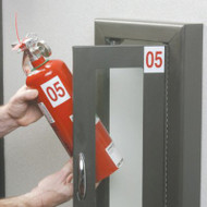 A photograph of a 09371 fire extinguisher numbering pack in use on fire extinguisher and fire extinguisher cabinet.