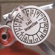 Punched tag shown attached to a fire extinguisher.