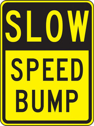 A photograph of a black and yellow 06250 speed bump sign, reading slow speed bump.