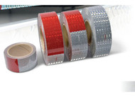 Photograph of 4 rolls of Conspicuity DOT-C2 Reflective Tape.