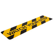 """A photograph of a yellow and black 06459 anti-slip stair cleats, reading watch your step, with 6"""" x 24"""" dimensions and 10 per package."""