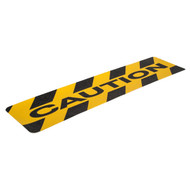 """A photograph of a yellow and black 06460 anti-slip stair cleat, reading caution, with 6"""" x 24"""" dimensions, and 10 per package ."""