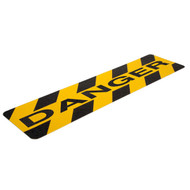 """A photograph of a yellow and black 06461 anti-slip stair cleat,  reading danger, with 6"""" x 24"""" dimensions, and 10 per package."""