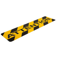 """A photograph of a yellow and black 06462 anti-slip stair cleat, reading attention, with 6"""" x 24"""" dimensions, and 10 per package."""