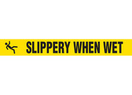 """Picture of Printed Warning Tape reading """"Slippery When Wet"""" in black lettering on yellow background."""