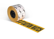 """Photograph of a roll of  Anti-Slip Printed Warning Tape reading """"Caution Watch Your Step"""" in black lettering on a yellow background."""