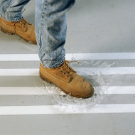 A photograph of 06469 waterproof anti-skid tape in use on floor of a facility.