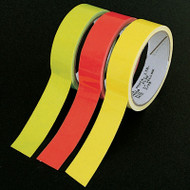A photograph of three rolls of 06474 fluorescent tape with a several inches extended from each. Left to right: green, orange, yellow.