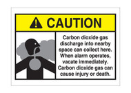 A photograph of a 09951 CO2 system signs, reading caution carbon dioxide gas discharge into nearby space can collect here, with graphic.