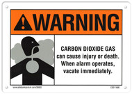 A photograph of a 09955 CO2 system sign, reading warning - carbon dioxide gas can cause injury or death, when alarm operates, vacate immediately, with graphic.