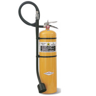 A photograph of side of a yellow 30 lb 09590 amerex model B570 class D sodium chloride fire extinguisher.