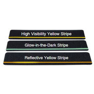 A photograph comparing high visibility, glow-in-the-dark, and reflective stripes on cleats.