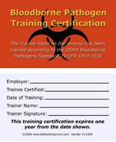 A photograph of front and back of an orange 11500 bloodborne pathogen training certification card.