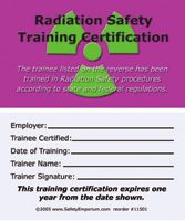 A photograph of front and back of a purple 11501 radiation safety training certification card.