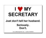 A photograph of a 12026 witty workplace label reading I love my secretary just don't tell her husband seriously don't.