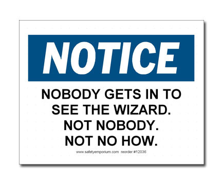 A photograph of a 12036 witty workplace label reading notice nobody gets in to see the wizard not nobody not no how.