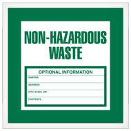 A photograph of a green and white 12324 non-hazardous waste label, with 500 per roll.