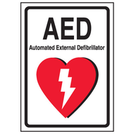 A photograph of a 13005 AED label reading AED automatic external defibrillator with graphic.