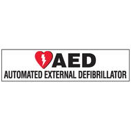 A photograph of a 13006 landscape AED label reading AED automated external defibrillator with graphic.