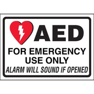 A photograph of a 13008 AED label reading AED for emergency use only alarm will sound if opened with graphic.