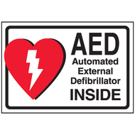 A photograph of a 13009 AED label reading AED automatic external defibrillator inside with graphic.