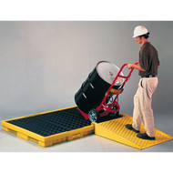 A photograph of a 04314 poly ramp for low-profile modular spill platform and pallets in use.
