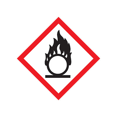 A red and white photograph of a 03601 GHS flame pictogram label.