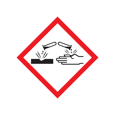 A photograph of a 03603 GHS corrosion pictogram labels.