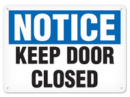 A photograph of a 01650 notice keep door closed OSHA sign.