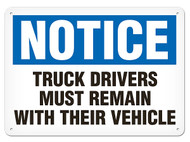 A photograph of a 01644 notice truck drivers must remain with their vehicle OSHA sign.