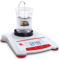 Photograph of a Ohaus Density Determination Kit for Scout® Balances in use (beaker and balance not included).