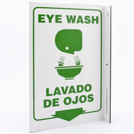 A photograph of a 00263-gl bilingual english/spanish eye wash wall-projecting l-sign w/ graphics.