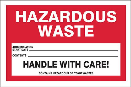 A photograph of a red and white 12325 hazardous waste label, reading hazardous waste.