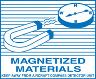 A photograph of a blue and white 12334 hazardous material shipping label, reading magnetized materials with illustration.
