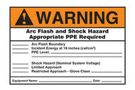 A photograph of an orange and white 07322 ANSI warning arc flash label and signs with user information blanks.