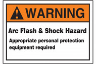 A photograph of an orange and white 07336 ANSI warning arc flash label, with basic text.