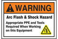 A photograph of an orange and white 07337 ANSI warning arc flash label with arc flash icon.