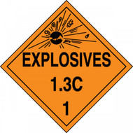 An orange and black photograph of a 03082 dot explosives placards, reading explosives 1.3C 1 with graphic.