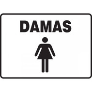 A photograph of a black and white 03474 spanish restroom sign with graphic, reading damas .