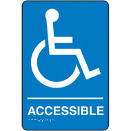 """A photograph of a blue and white 03501 accessible ADA braille tactile sign, with international accessibility symbol, and dimensions 6"""" x 9""""."""