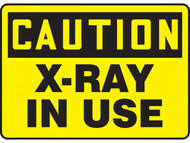 A photograph of a 01600 caution x-ray in use osha signs.