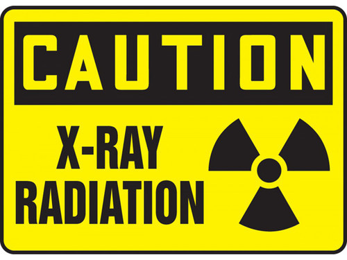 A photograph of a 01601 caution x-ray radiation osha signs with radiation symbol.