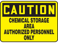 A photograph of a yellow and black 01552 caution chemical storage area authorized personnel only OSHA sign.